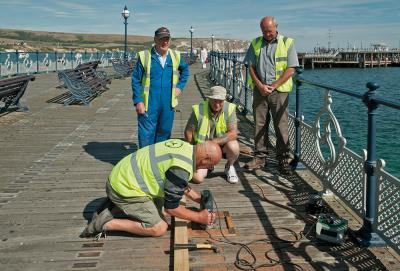 fitting plaques on the decking(1)